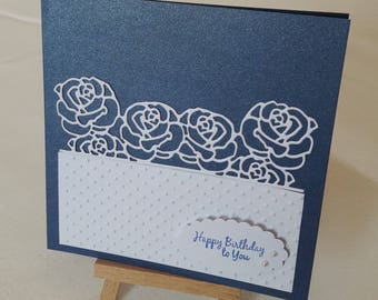 White roses on a blue background