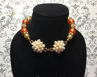 Orange double pearl cluster