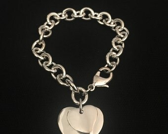 Silver link bracelet with hearts charm