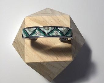 Weaving of beads and silver metal cuff