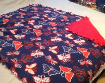 Pretty red, white, and blue butterfly double fleece blanket.  Sewn, not tied.  54x58