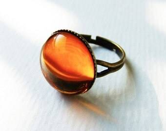 ring with amber topaz color cabochon