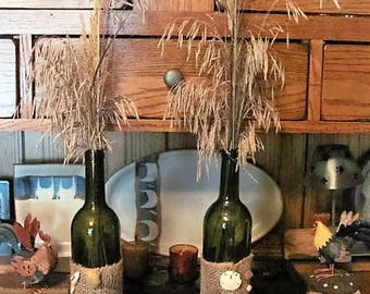 Natural grass containers with sea shells and driftwood