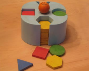 Vintage Playskool Shape Sorter with smiley knob and wooden shapes