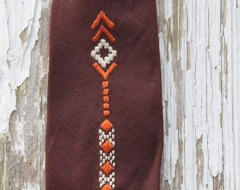Brown skinny tie with small orange and white embroidered geometric pattern, cotton tie, 1970s, father's day,