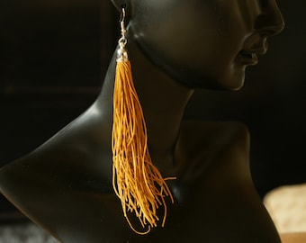 Hand made yellow leather tassel earrings Gyppo & Glitterati from France.