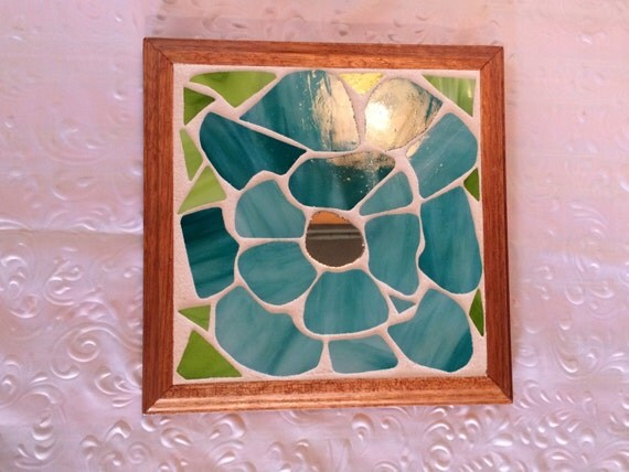 Light blue poppy with mirrored center and mahogany trim.