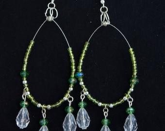 Luxuriously ornate statement chandelier green earrings