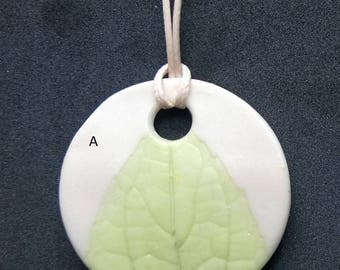 Large round pendant with leaf imprint