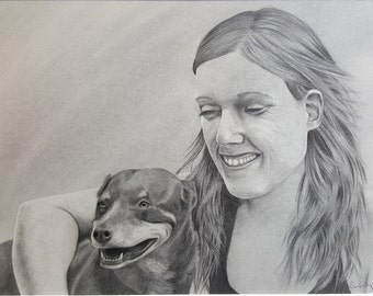 Original portrait drawing of a girl and a dog in graphite art - 'Ruby and Friend' (framed)