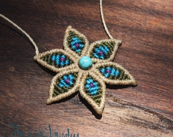 Handmade macrame flower necklace. Color cream, green and blue.