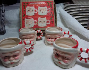 A dansan original ceramic noel set of 4 small Santa mugs. These are decorative. Have box, estate found.