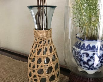 Glass carafe wrapped in rattan