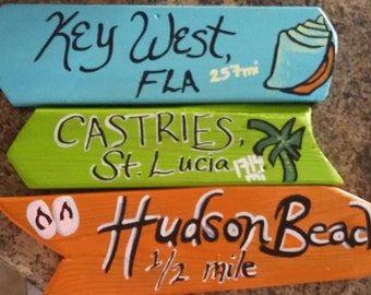 Tropical Directional Signs, arrow signs, mileage signs, key west signs, direction signs with miles, signs for trees, wooden signs