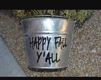 Personalize your metal bucket with a vinyl saying. Great for wedding decor or home decor.