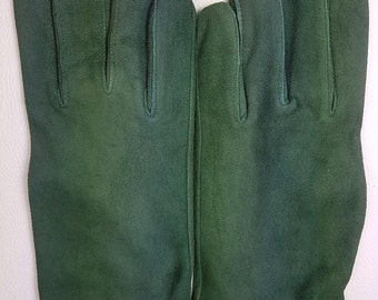 Green woman in leather gloves