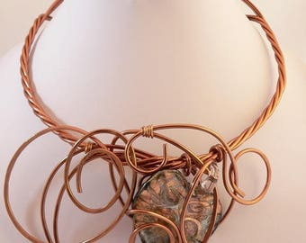 Copper wire statement necklace with a lamp work bronze coloured bead.Bold and Chunky.Unique wearable art .Modern and abstract.