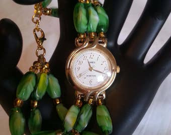 Timex old to new again wrist watch / green and gold bead band