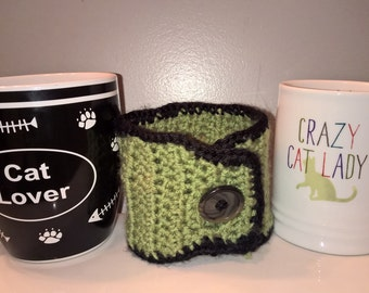 coffee cup cozy. green and black. Tea, Coffee, Mug