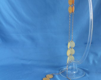 """Chanel necklace, long, hand made, entitled """"hymn to the Sun"""" made with chains and vintage floppies."""