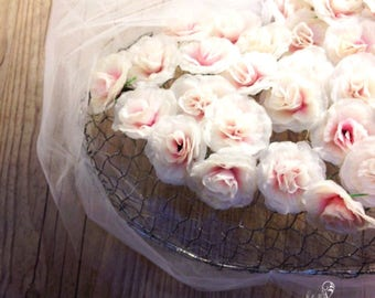 Caged heart covered with pink flowers wedding decoration