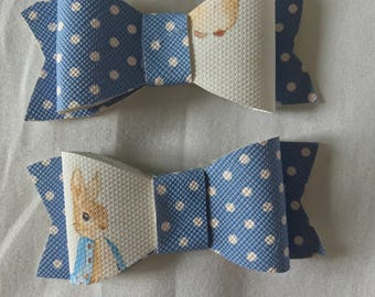 Pair of fabric or glitter bows