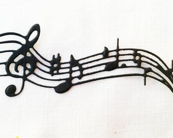 40 staff with musical notes in paper