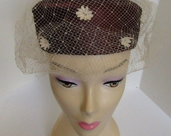 1960's burgundy pill box hat with flowers and cream veil