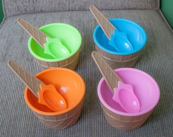 Ice with spoons, 4 colorful bowls cups