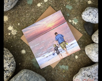 Father and Son walking and paddling on the Beach in fishguard Wales blank Greeting card
