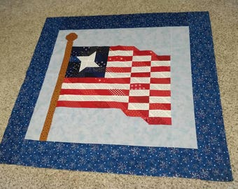 Scrappy flag quilt top