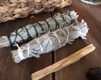 Two six inch sage smudge sticks with a piece of palo santo