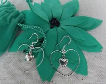 Heart Earrings. Lovely and elegant silver plated Heart Earrings.