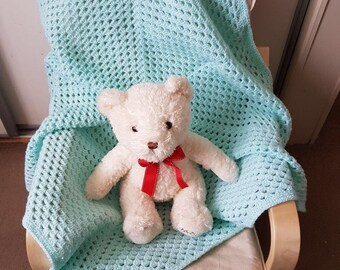 Handmade turquoise crochet baby blanket