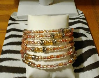Beautiful coil wrap bracelet with electroplated color change glass accents in bubble gum colors