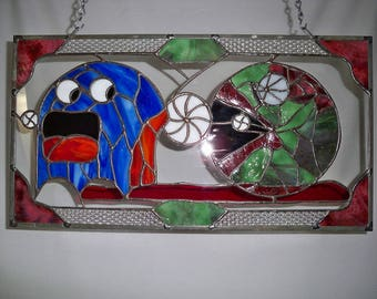 Stained Glass Zombie, Pac-Man chomping on a ghost