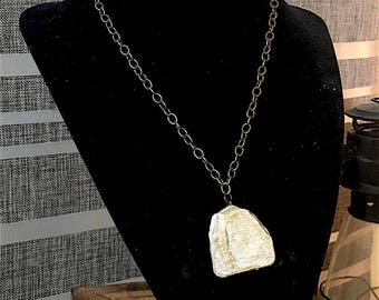 Short, choker-like plaster pendant. Handcrafted, one of a kind