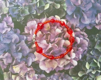Red glass and acrylic bead bracelet