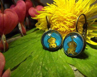 Blue etched brass pouncing cat earrings