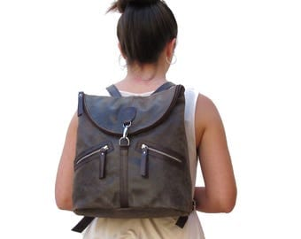 Brown leather backpack for women. Backpack with pockets and adjustable straps.