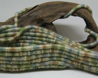 Free form earthtone basket designed on driftwood
