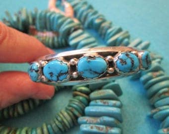 "Vivid Blue Turquoise & Sterling Navajo bracelet>> 5 Polished Nuggets>> signed> in excellent condition>> Color just ""POPS"" against your skin!"