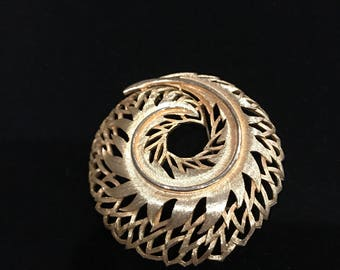 Abstract style gold tone broach