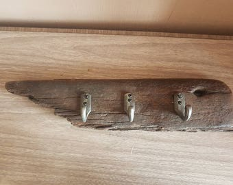 Unique piece of driftwood transformed into a vintage style coat hook rack