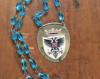 Fire breathing bird vintage tin necklace