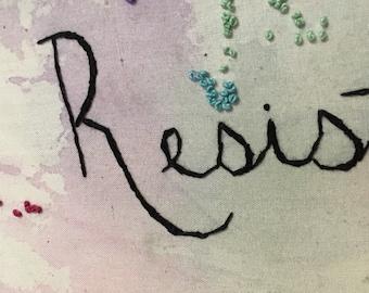Resist embroidery hoop art
