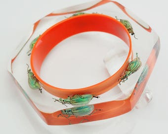 Beautiful bright orange faceted lucite bracelet with real bugs