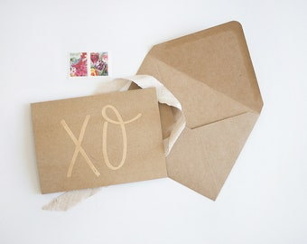 xo | embossed card with custom calligraphed messaged