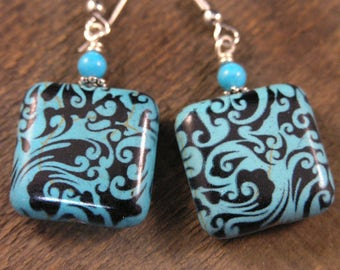 Turquoise stone with ornate pattern and silver handmade earrings