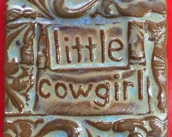 little cowgirl handmade earthenware tile by tilesmile